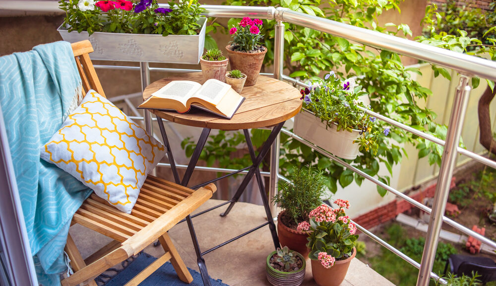 Beautiful,Terrace,Or,Balcony,With,Small,Table,,Chair,And,Flowers