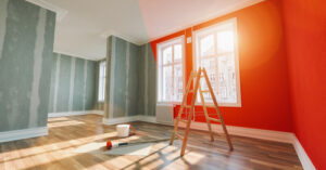 Painting,Wall,Red,In,Room,Before,And,After,Restoration,Or
